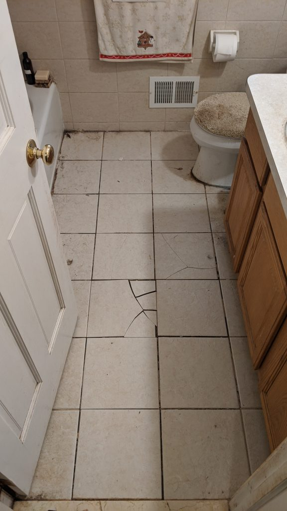 Cracked and loose floor tiles